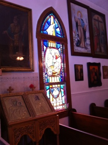 This area is to the side of the candles and displays nicely one of the beautiful stained glass windows